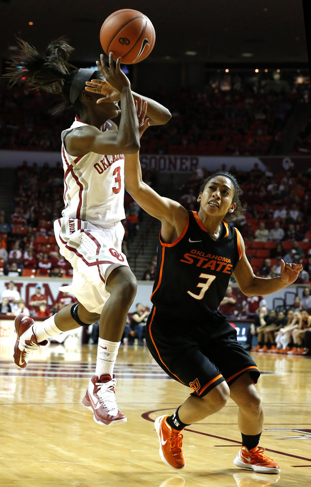 Photo - Oklahoma's Aaryn Ellenberg (3) shoots as Oklahoma State's Tiffany Bias (3) defends during the women's Bedlam basketball game between Oklahoma State University and Oklahoma at the Lloyd Noble Center in Norman, Okla., Sunday, Feb. 10, 2013.Photo by Sarah Phipps, The Oklahoman