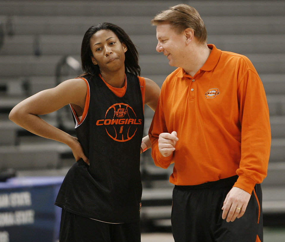 Oklahoma State University coach Kurt Budke talks with Dominique Chism during practice day for the first round of the women's NCAA basketball tournament in the Jack Breslin Arena at Michigan State University on Saturday, March 17, 2007, in East Lansing, Mich.   staff photo by CHRIS LANDSBERGER