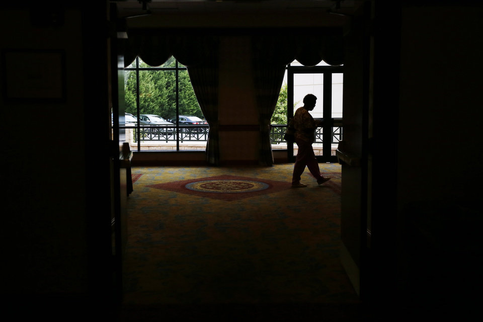 Photo - In this June 24 2013, photo, a job seeker exits after attending a career fair, in King of Prussia, Pa. The Labor Department reports on the number of Americans who applied for unemployment benefits last week on July 11, 2013. (AP Photo/Matt Slocum)