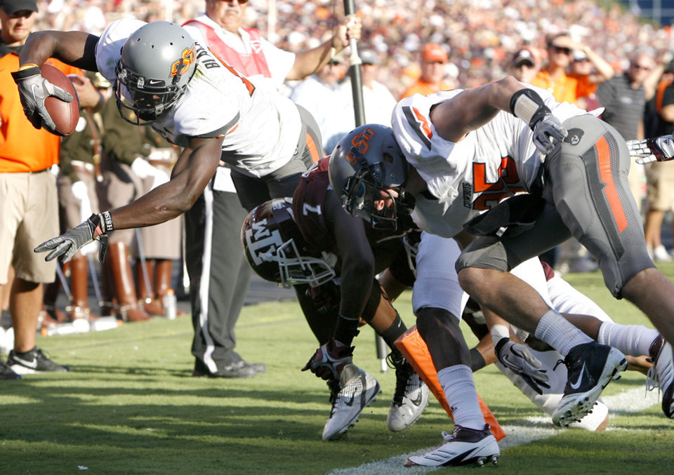 Oklahoma State's Justin Blackmon dives for yardage in the second half of the Cowboys' win over Texas A&M on Saturday in College Station, Texas. Photo by Sarah Phipps, The Oklahoman