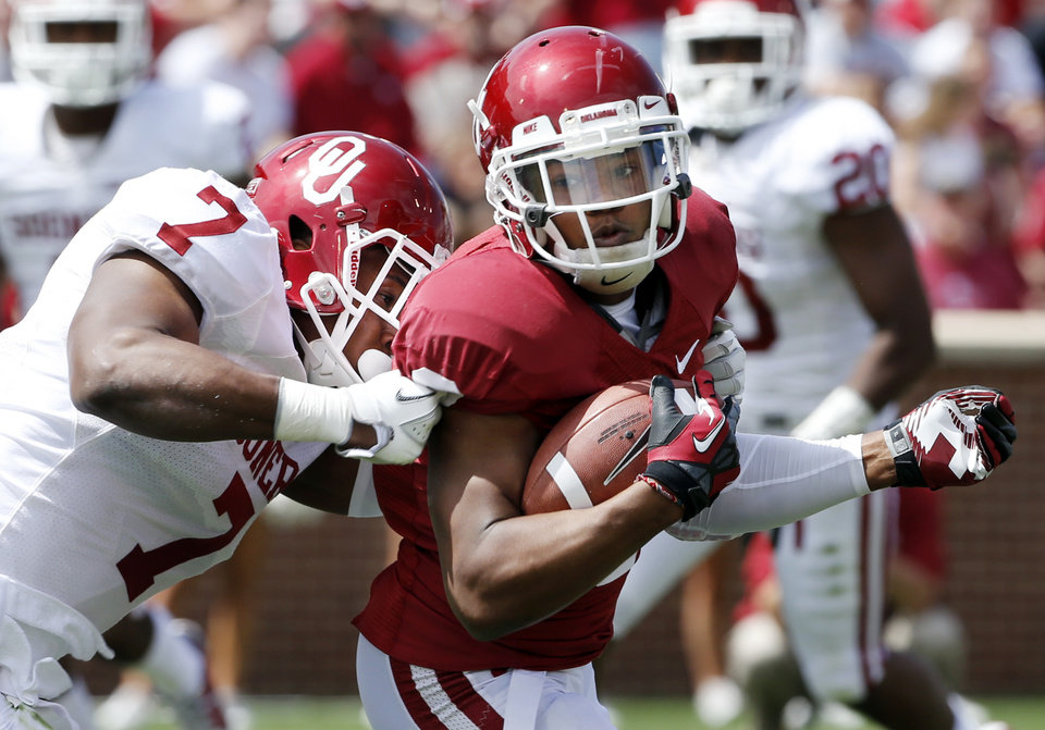 Photo - Sterling Shepard, right, tries to break the tackle of Corey Nelson (7) during the annual Spring Football Game at Gaylord Family-Oklahoma Memorial Stadium in Norman, Okla., on Saturday, April 13, 2013. Photo by Steve Sisney, The Oklahoman