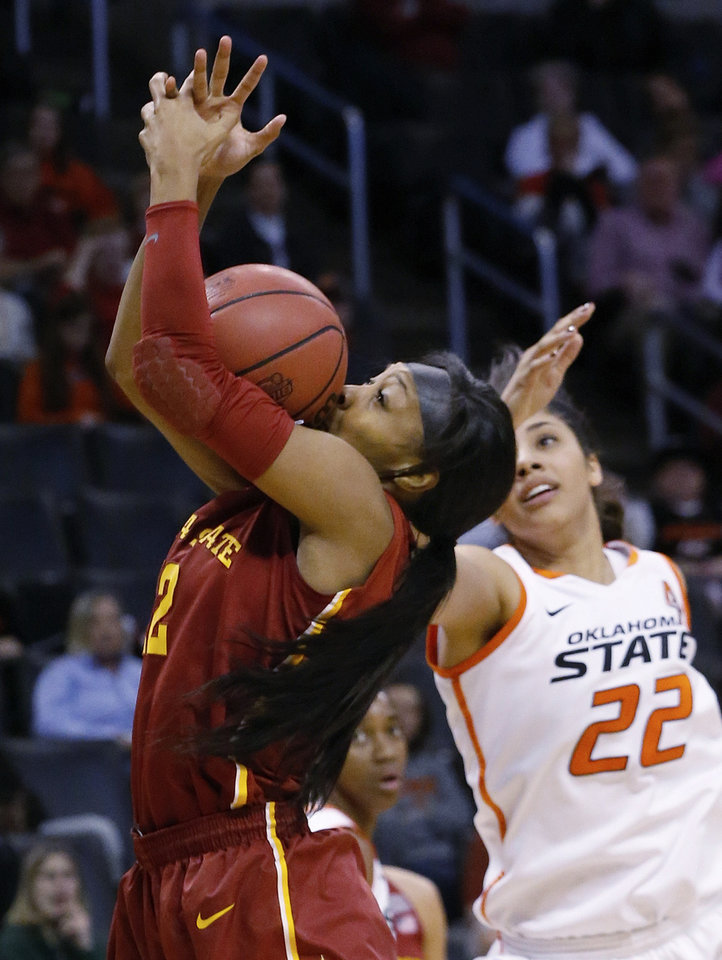 Photo - Iowa State guard Seanna Johnson (12) grabs a rebound in front of Oklahoma State guard Brittney Martin (22) in the second half of an NCAA college basketball game in the quarterfinals of the Big 12 Conference women's college tournament in Oklahoma City, Saturday, March 8, 2014. Oklahoma State won 67-57. (AP Photo/Sue Ogrocki)