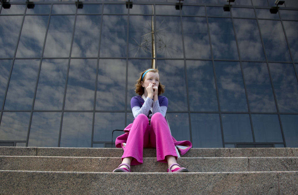 Photo - Fay Wagstaff of El Paso, Texas. sits on the front steps of the closed Smithsonian National Air and Space Museum in Washington, Tuesday, Oct. 1, 2013. Congress plunged the nation into a partial government shutdown Tuesday as a long-running dispute over President Barack Obama's health care law stalled a temporary funding bill, forcing about 800,000 federal workers off the job and suspending most non-essential federal programs and services. (AP Photo/Carolyn Kaster)