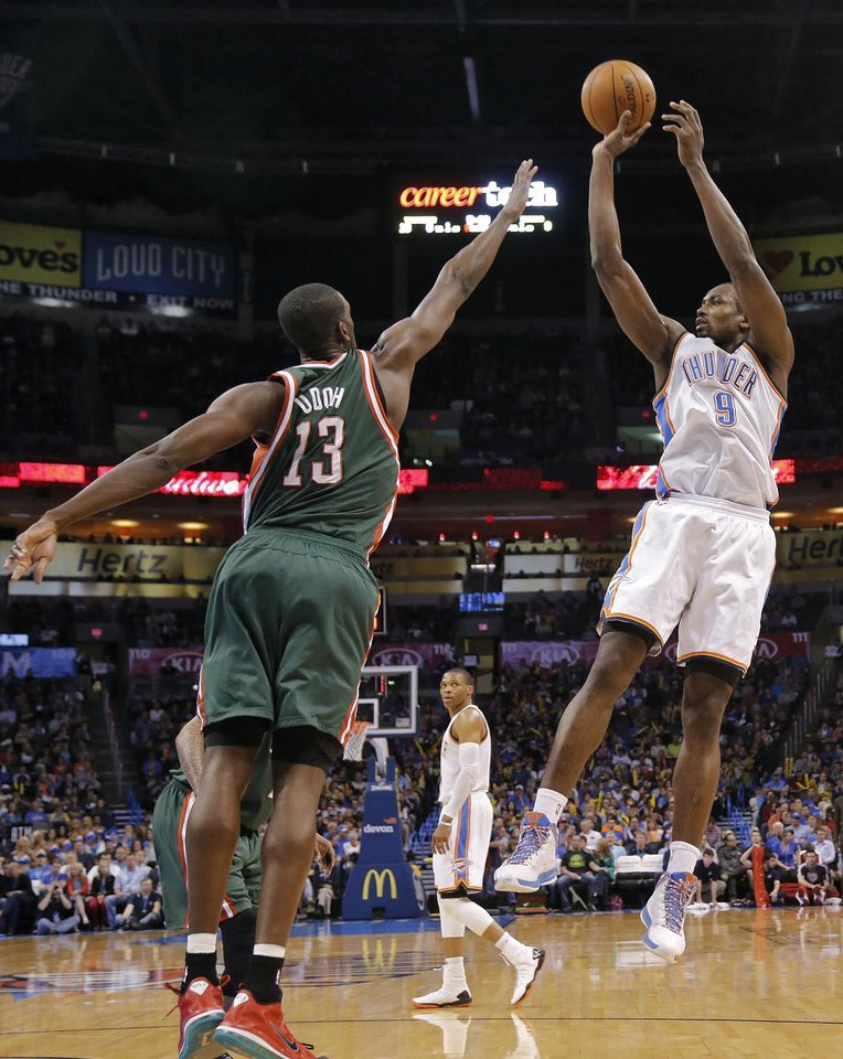 Oklahoma City's Serge Ibaka (9) shoots over Milwaukee 's Ekpe Udoh (13) during the season finally NBA basketball game between the Oklahoma City Thunder and the Milwaukee Bucks at Chesapeake Energy Arena on Wednesday, April 17, 2013, in Oklahoma City, Okla.   Photo by Chris Landsberger, The Oklahoman