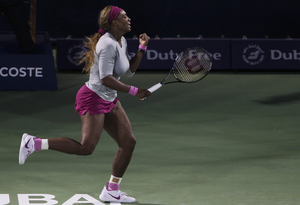 Photo - Serena Williams of the U.S. reacts after winning a point against Ekaterina Makarova of Russia during the second round of Dubai Duty Free Tennis Championships in Dubai, United Arab Emirates, Tuesday, Feb. 18, 2014. (AP Photo/Kamran Jebreili)