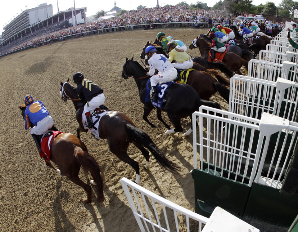 Photo - In a photo taken with a fish eye lens, horses leave the starting gate in the 138th Kentucky Derby horse race at Churchill Downs Saturday, May 5, 2012, in Louisville, Ky. (AP Photo/Matt Slocum)  ORG XMIT: DBY210