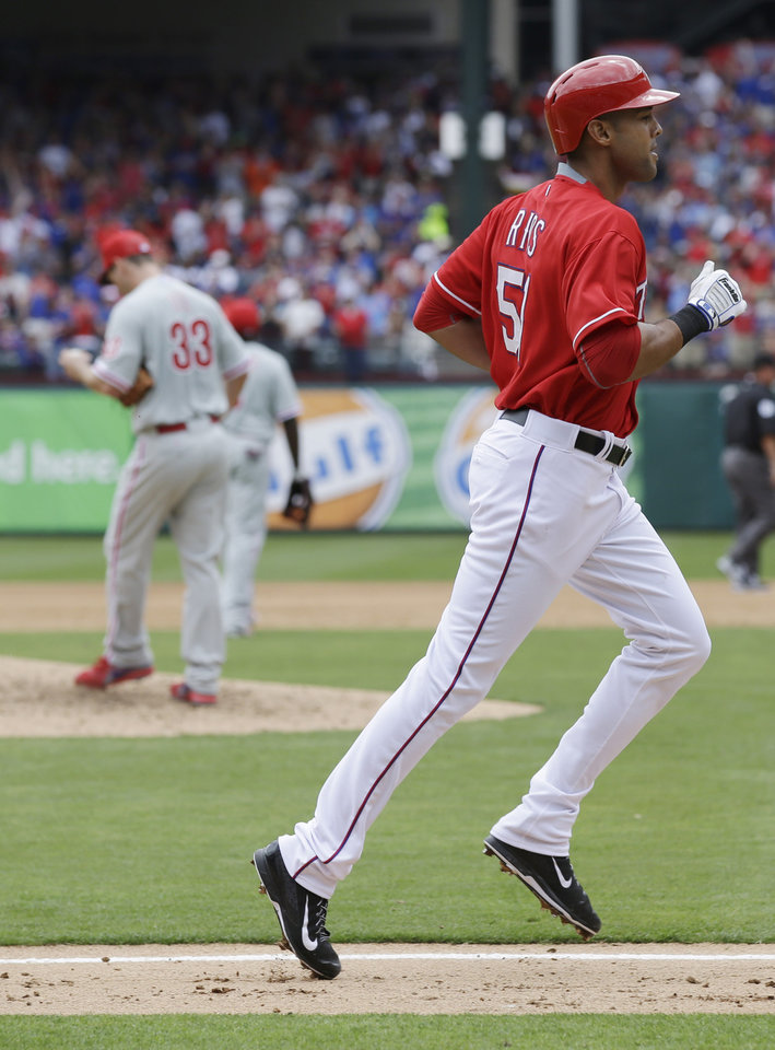 Photo - Texas Rangers' Alex Rios heads to home after hitting a three-run home run off Philadelphia Phillies starting pitcher Cliff Lee during the third inning of an opening day baseball game at Globe Life Park, Monday, March 31, 2014, in Arlington, Texas.  (AP Photo/Tony Gutierrez)