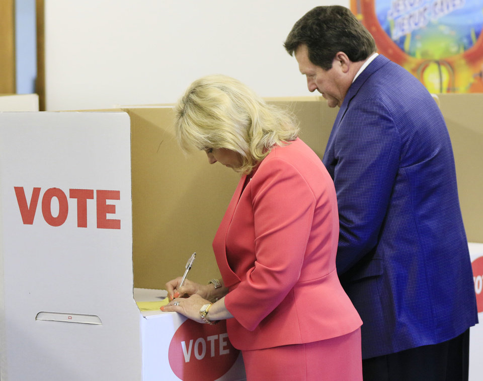 Photo - Oklahoma Governor Mary Fallin and her husband Wade Christensen vote at their polling place at Prospect Baptist Church in Oklahoma City, Okla. during the primary election, Tuesday, June 28, 2016.  Photo by Paul Hellstern, The Oklahoman