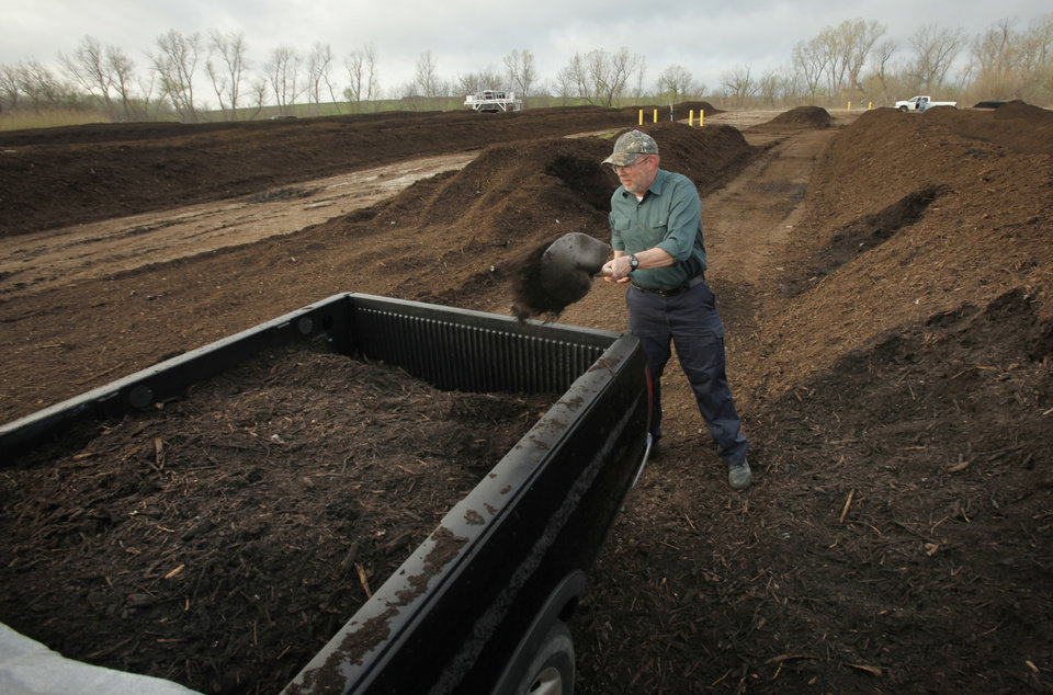 Everett Dale loads his own compost as Norman residents get free compost from the city's composting facility on Saturday, March 17, 2012, in Norman, Okla.   Photo by Steve Sisney, The Oklahoman
