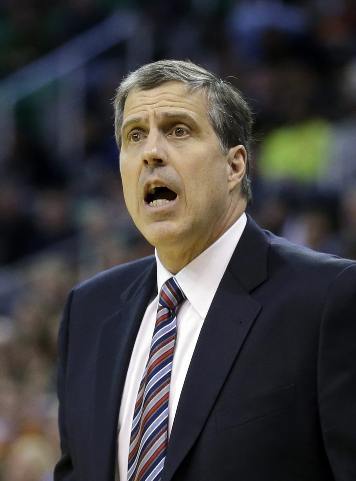 Photo - Washington Wizards coach Randy Wittman shouts to his team during the second quarter of an NBA basketball game against the Utah Jazz on Saturday, Jan. 25, 2014, in Salt Lake City. (AP Photo/Rick Bowmer)