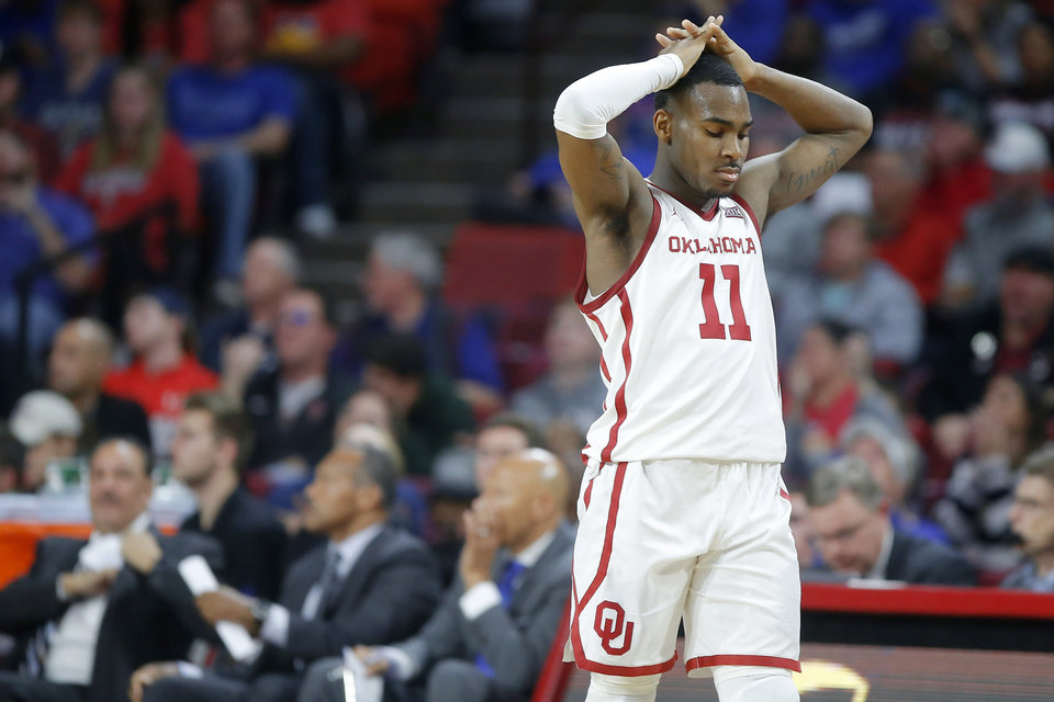 Photo - Oklahoma's De'Vion Harmon (11) walks back toward the bench during an NCAA college basketball game between the University of Oklahoma Sooners (OU) and the University of Kansas Jayhawks at Lloyd Noble Center in Norman, Okla., Tuesday, Jan. 14, 2020. Oklahoma lost 66-52.  [Bryan Terry/The Oklahoman]