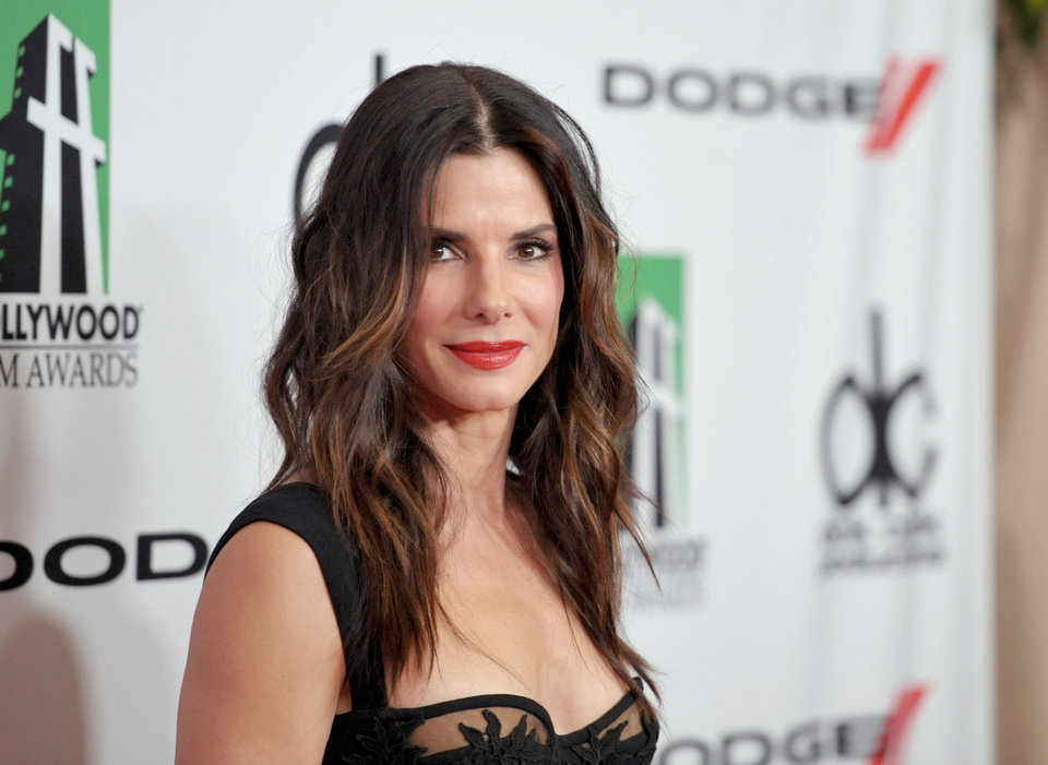 Photo - FILE - In this Oct. 21, 2013 file photo, Sandra Bullock arrives at the 17th Annual Hollywood Film Awards Gala at the Beverly Hilton Hotel in Beverly Hills, Calif. Bullock scored five nominations for the People's Choice Awards airing on CBS, Wednesday, Jan. 8, 2014. The
