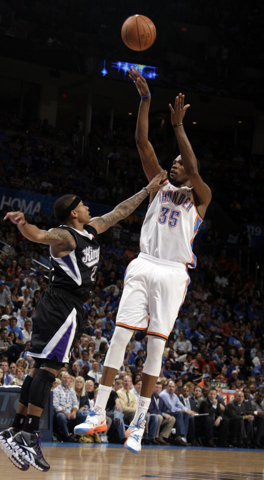 Oklahoma City's Kevin Durant (35) shoots over Sacramento's Isaiah Thomas (22) during the NBA basketball game between the Oklahoma City Thunder and the Sacramento Kings at Chesapeake Energy Arena in Oklahoma City, Tuesday, April 24, 2012. Photo by Sarah Phipps, The Oklahoman.