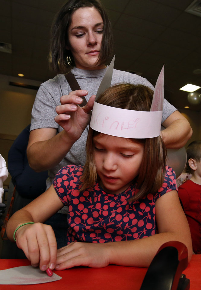 Kari Foster adjusts the cat ears on her daughter Makinlei as they participate in an election day party at the Moore Library on Tuesday, Nov. 6, 2012 in Moore , Okla.  Photo by Steve Sisney, The Oklahoman
