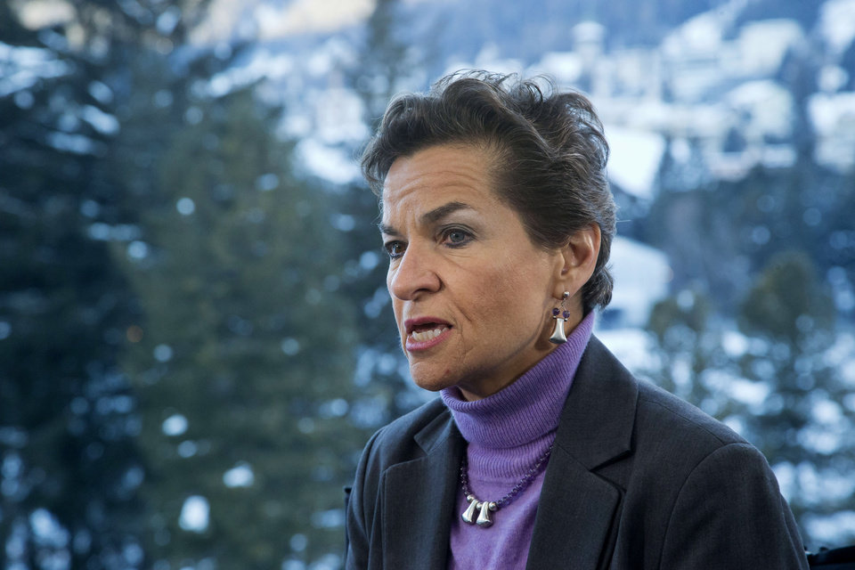 Photo - U.N. climate chief Christiana Figueres, speaks during an interview with the Associated Press at the World Economic Forum in Davos, Switzerland, Wednesday, Jan. 22, 2014, the opening day of the World Economic Forum where world's financial and political elite will meet in the upcoming days. (AP Photo/Michel Euler)