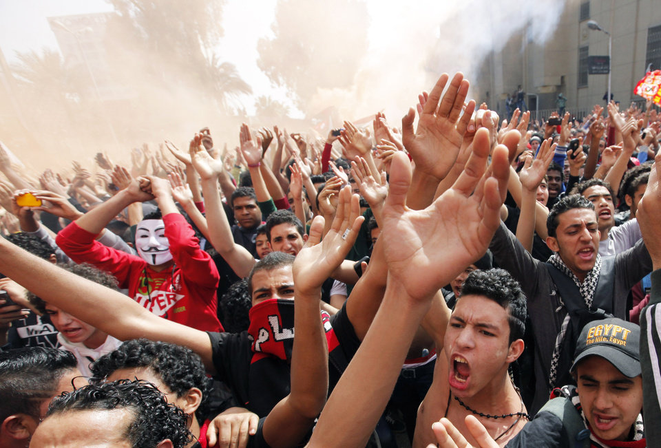Photo - Egyptian soccer fans of the Al-Ahly club celebrate in front of their club in Cairo, Egypt, after an Egyptian court confirmed death sentences against 21 people for their role in a deadly 2012 soccer riot that killed more than 70 people in the city of Port Said, Saturday, March 9, 2013. (AP Photo/Amr Nabil)