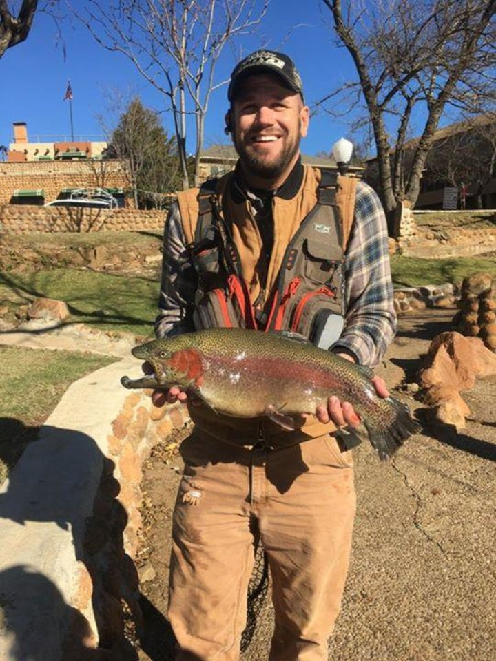 Photo -  Michael Edmondson of Cyril recently caught this 8-pound rainbow trout at Medicine Creek. (Photo provided)