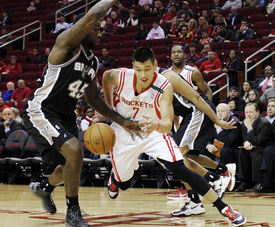 Houston Rockets' Jeremy Lin (7) tries to drives the ball around San Antonio Spurs' DeJuan Blair (45) in the first half of an NBA basketball game, Monday, Dec. 10, 2012, in Houston. (AP Photo/Pat Sullivan)