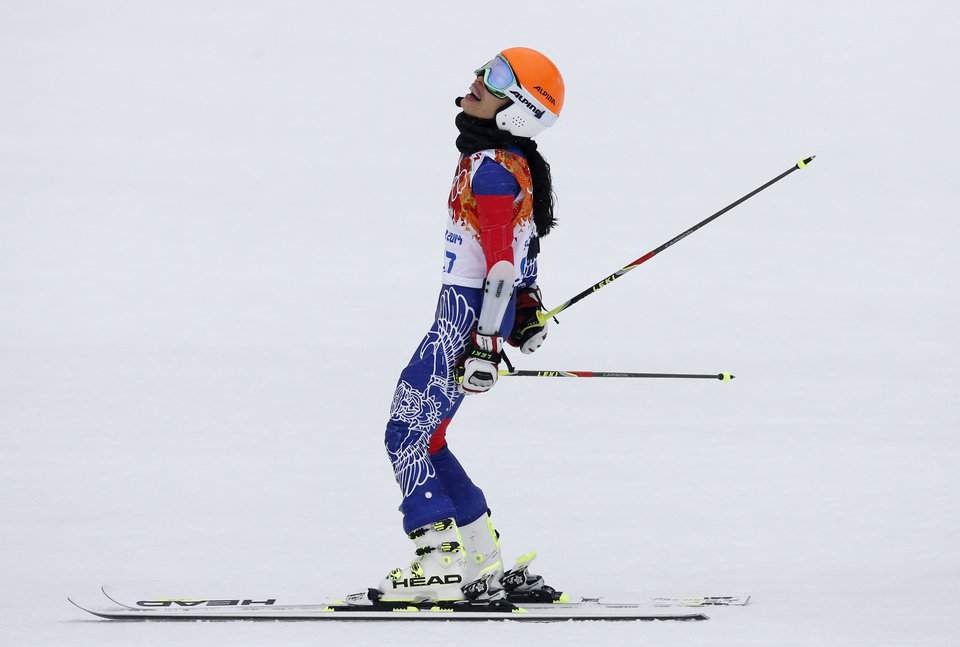 Photo - Violinst Vanessa Mae, starting under her father's name as Vanessa Vanakorn for Thailand, reacts after finishing the second run of the women's giant slalom at the Sochi 2014 Winter Olympics, Tuesday, Feb. 18, 2014, in Krasnaya Polyana, Russia.(AP Photo/Christophe Ena)