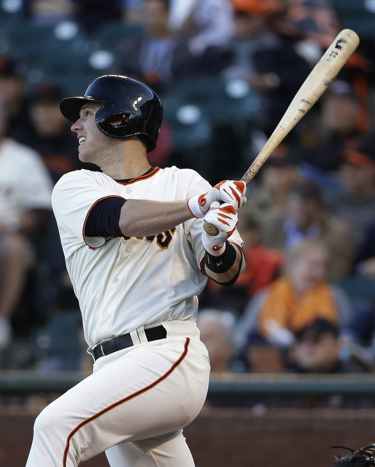 Photo - San Francisco Giants' Buster Posey doubles to right field off Cincinnati Reds starting pitcher Mike Leake in the first inning of their baseball game Thursday, June 26, 2014, in San Francisco. (AP Photo/Eric Risberg)