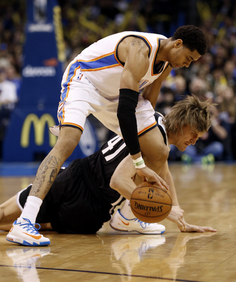 Photo - Brooklyn's Andrei Kirilenko tries to steal the ball from Thunder's Jeremy Lamb in the second half of an NBA basketball game where the Oklahoma City Thunder were defeated 95-93 by the Brooklyn Nets at the Chesapeake Energy Arena in Oklahoma City, on Thursday, Jan. 2, 2014. Photo by Steve Sisney, The Oklahoman