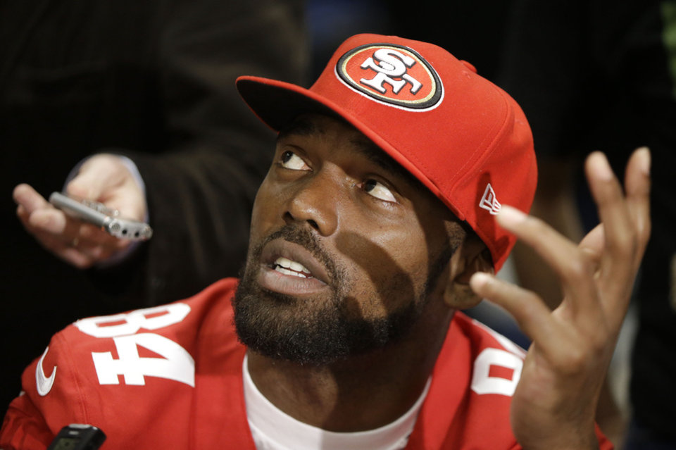 Photo - San Francisco 49ers wide receiver Randy Moss talks with reporters on Thursday, Jan. 31, 2013, in New Orleans. The 49ers are scheduled to play the Baltimore Ravens in the NFL Super Bowl XLVII football game on Feb. 3. (AP Photo/Mark Humphrey)