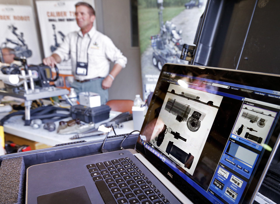 Photo -  An image is displayed on a computer from a Logos Imaging device at the International Association of Bomb Technicians and Investigators regional training conference, hosted by the Norman Police Department. [PHOTO BY STEVE SISNEY, THE OKLAHOMAN]