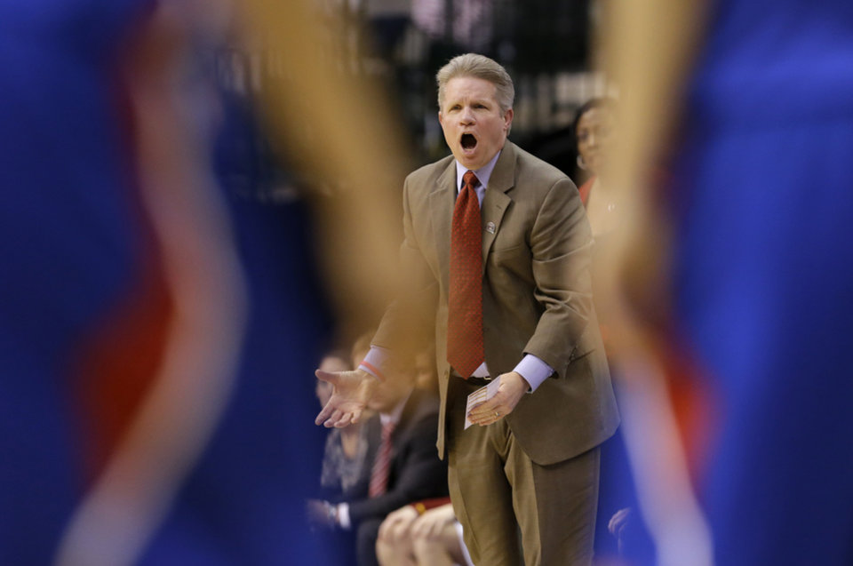 Photo - Iowa State coach Bill Fennelly shouts at an official, looking for a foul call against Kansas in the first half of an NCAA college basketball game in the Big 12 women's tournament Saturday, March 9, 2013, in Dallas. (AP Photo/Tony Gutierrez)
