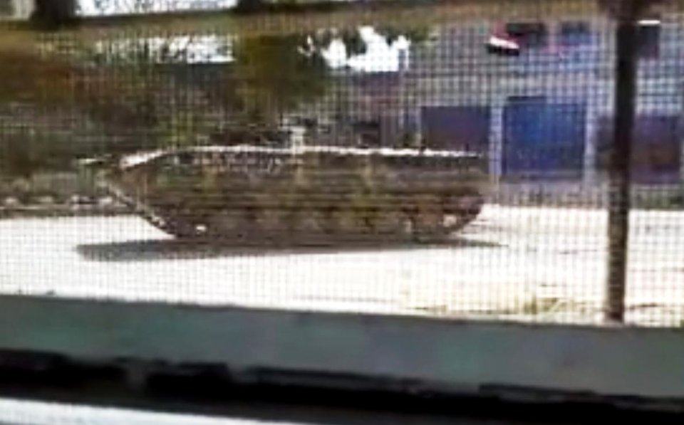 Photo -   This image made from amateur video released by the Shaam News Network and accessed Thursday, April 12, 2012, purports to show a Syrian military armored vehicle in Idlib, Syria. Syrian forces halted attacks on opposition strongholds Thursday in line with a U.N.-brokered truce but the regime defied demands by international envoy Kofi Annan to pull troops back to their barracks, activists said. (AP Photo/Shaam News Network via AP video) TV OUT, THE ASSOCIATED PRESS CANNOT INDEPENDENTLY VERIFY THE CONTENT, DATE, LOCATION OR AUTHENTICITY OF THIS MATERIAL