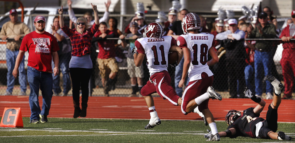 Wynnewood Pete Knowles races down the sideline, trailed by teammate Derek Schafer,  to score a second quarter touchdown.  Making an attempt to stop him is Cashion defender Peyton Maroney. Cashion vs. Wynnewood at Norman in a Class A semifinal football game, Saturday, Dec. 1, 2012.     Photo by Jim Beckel, The Oklahoman
