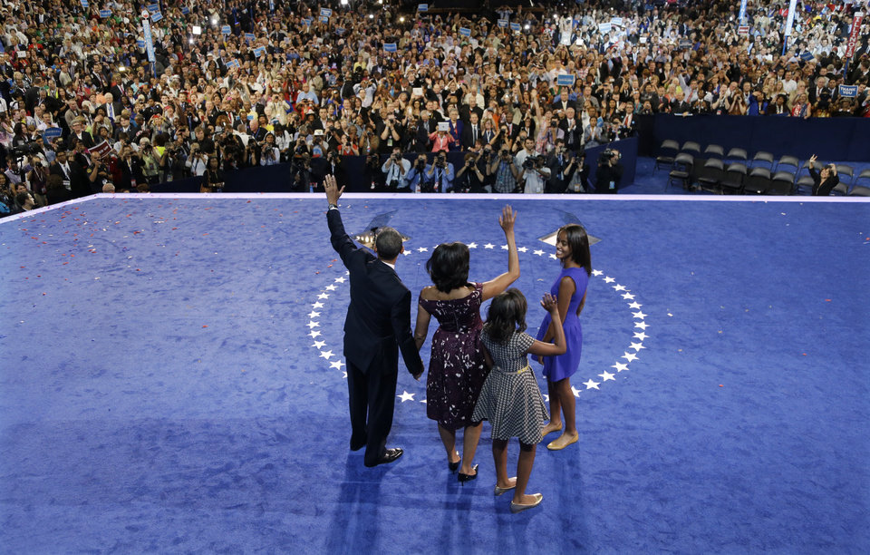 Photo -   President Barack Obama waves with his wife Michelle and his daughters Malia and Sasha after his speech to the Democratic National Convention in Charlotte, N.C., on Thursday, Sept. 6, 2012. (AP Photo/Charlie Neibergall)