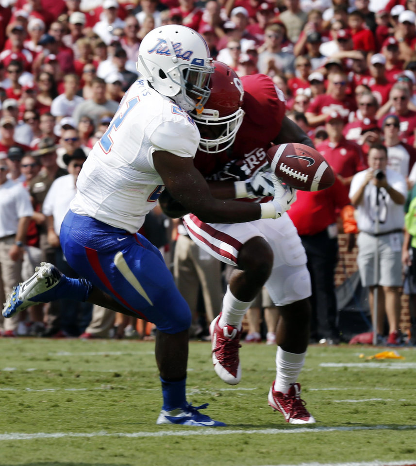 Oklahoma's Gabe Lynn (9) breaks up a pass intended for Trey Watts (22) and is called for a head to head contact during a college football game between the University of Oklahoma Sooners (OU) and the Tulsa Golden Hurricane (TU) at Gaylord Family-Oklahoma Memorial Stadium in Norman, Okla., on Saturday, Sept. 14, 2013. Photo by Steve Sisney, The Oklahoman