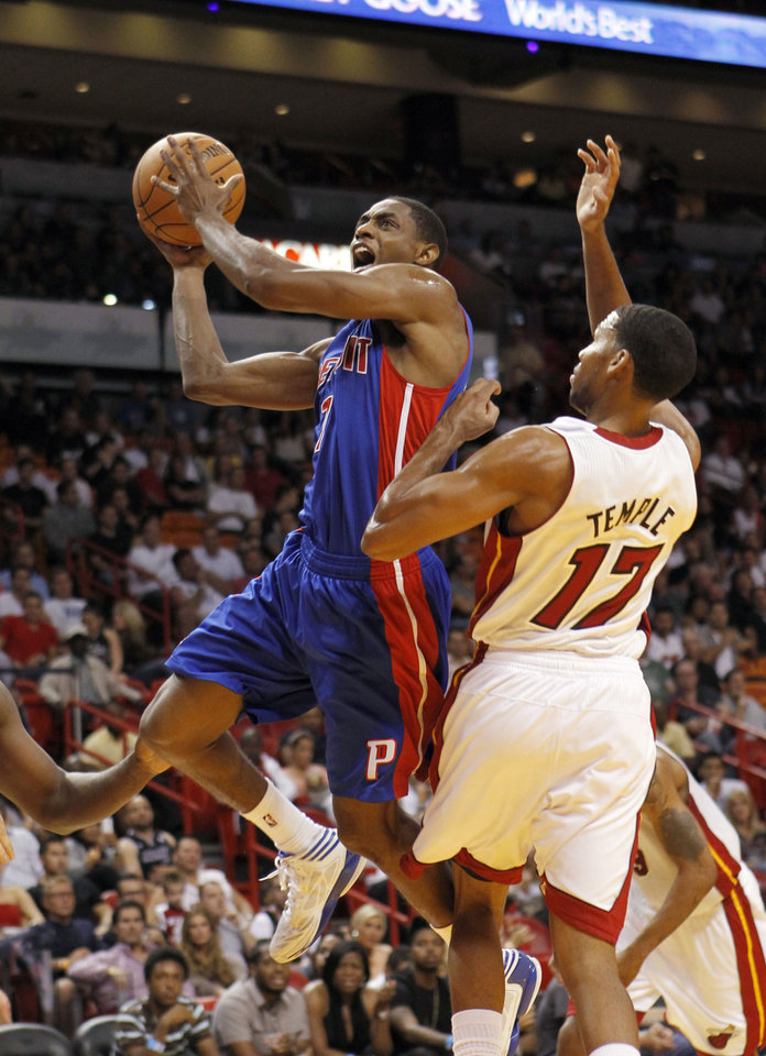 Photo -   Detroit Pistons' Brandon Knight (7) goes to the basket as Miami Heat's Garrett Temple (17) defends during the first half of a preseason NBA basketball game in Miami, Thursday, Oct. 18, 2012. (AP Photo/Alan Diaz)