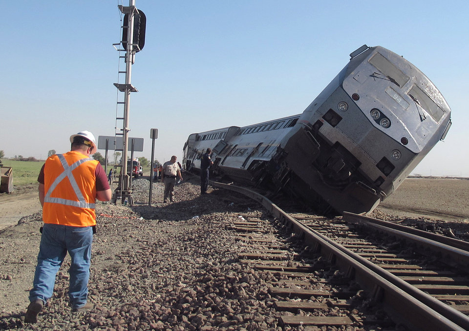Emergency personnel respond to the scene of a train derailment in Hanford, Calif., Monday, Oct. 1, 2012. Two cars and the locomotive of the train car derailed after colliding with a big rig truck in California's Central Valley, authorities said. At least 20 passengers suffered minor to moderate injuries, authorities said. The crash occurred when the driver of the big rig carrying cotton trash failed to yield and hit the train, authorities said. The impact pushed the two passenger cars and the locomotive off the tracks south of Hanford, a farming town. (AP Photo/Gosia Woznicacka)