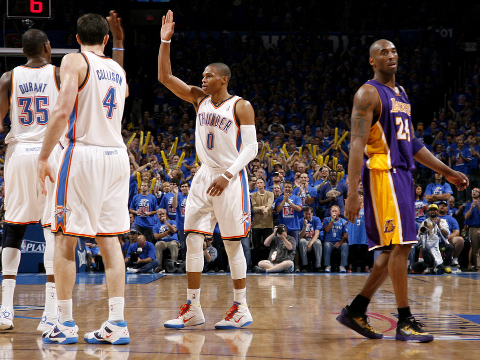 Oklahoma City's Russell Westbrook (0), Oklahoma City's Kevin Durant (35), and Nick Collison (4) celebrate beside Los Angeles' Kobe Bryant (24) during Game 5 in the second round of the NBA playoffs between the Oklahoma City Thunder and the L.A. Lakers at Chesapeake Energy Arena in Oklahoma City, Monday, May 21, 2012. Oklahoma City won 106-90.  Photo by Bryan Terry, The Oklahoman