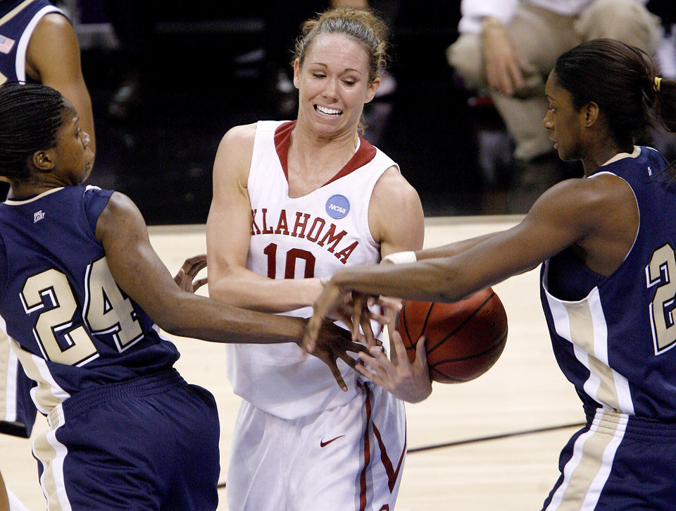OU's Carle Roethlisberger fights for the ball between Pittsburgh's Sarah Ogoke, left, and Chelsea Cole during the NCAA women's basketball tournament game between Oklahoma and Pittsburgh at the Ford Center in Oklahoma City, Sunday, March 29, 2009.  PHOTO BY BRYAN TERRY, THE OKLAHOMAN