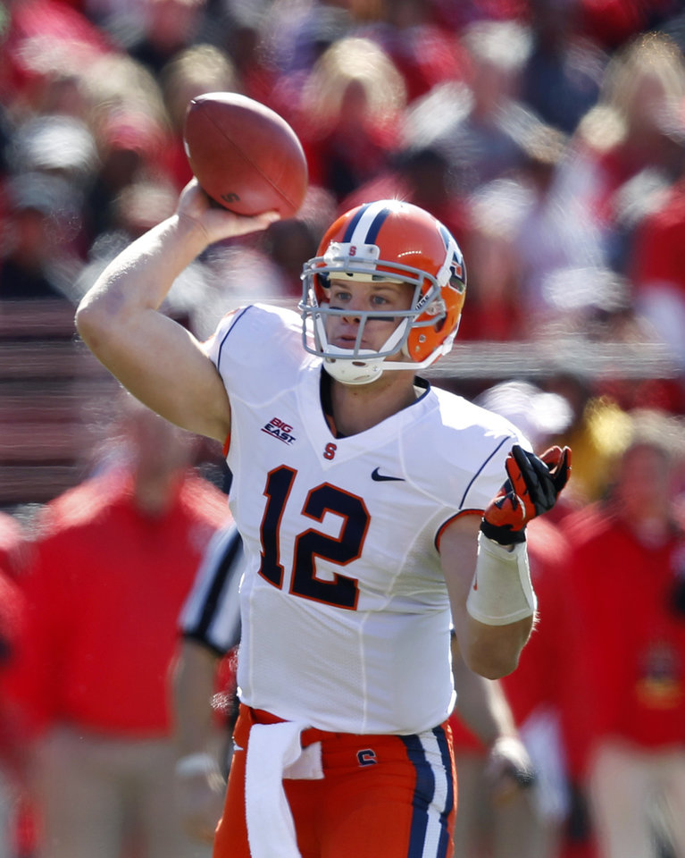 Photo -   Syracuse quarterback Ryan Nassib (12) throws a pass during the first half of an NCAA college football game against Rutgers at High Points Solutions stadium in Piscataway, N.J., Saturday, Oct. 13, 2012. (AP Photo/Mel Evans)