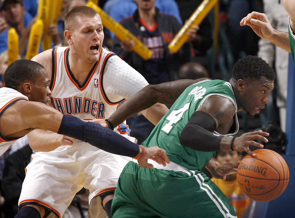 Photo - Oklahoma City's Russell Westbrook and Cole Aldrich pressure Nate Robinson during the NBA game between the Oklahoma City Thunder and the Boston Celtics, Sunday, Nov. 7, 2010, at the Oklahoma City Arena. Photo by Sarah Phipps, The Oklahoman