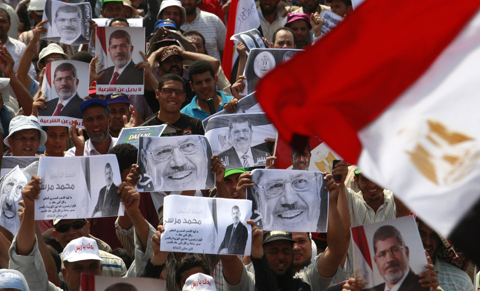 Photo - Supporters of ousted President Mohammed Morsi protest in Nasr City, Cairo, Egypt, Tuesday, July 9, 2013. Egypt's army chief says the military will not accept political