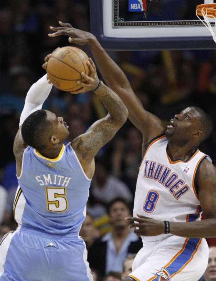 Oklahoma City Thunder center Nazr Mohammed, right, blocks a shot by Denver Nuggets forward J.R. Smith, left, in the fourth quarter of an NBA basketball game in Oklahoma City, Friday, April 8, 2011. Oklahoma City won 104-89. AP PHOTO <strong>Sue Ogrocki</strong>