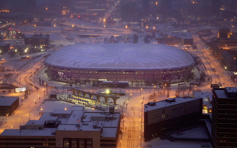 Photo - The Metrodome roof, seen from an upper floor of the U.S. Bank Building, is deflated shortly after 7 a.m. Saturday morning, Jan. 18, 2014 in Minneapolis. The 10 acres of Teflon-coated fabric were done deflating in 35 minutes. The deflation and the demolition of the Dome beginning next week will make way for construction of a new $1 billion Vikings stadium. (AP Photo/The Star Tribune, Jim Gehrz)  MANDATORY CREDIT; ST. PAUL PIONEER PRESS OUT; MAGS OUT; TWIN CITIES TV OUT