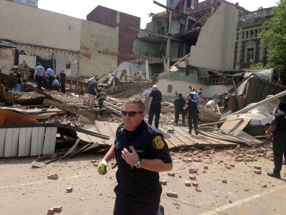 Photo - In this photo provided by Jordan McLaughlin, emergency personnel respond to a building collapse on the edge of downtown Philadelphia on Wednesday, June 5, 2013. A building that was being torn down collapsed with a thunderous boom, raining bricks on a neighboring thrift store, killing a woman and injuring at least 13 other people in an accident that witnesses said was bound to happen. (AP Photo/Jordan McLaughlin)