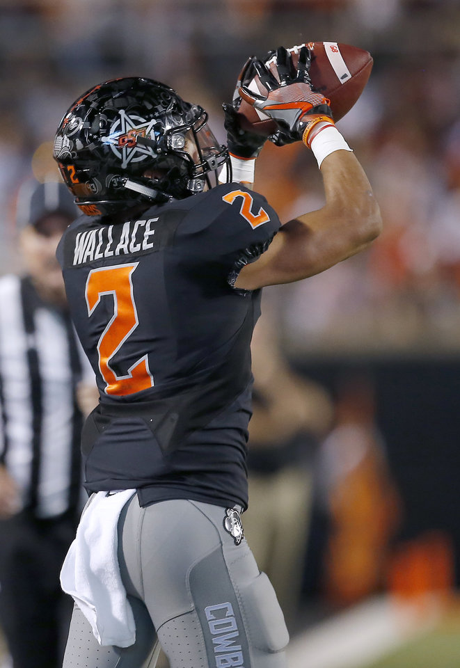 Photo - Oklahoma State's Tylan Wallace (2) makes a catch in the second quarter during a college football game between Oklahoma State (OSU) and South Alabama at Boone Pickens Stadium in Stillwater, Okla., Saturday, Sept. 8, 2018. Photo by Sarah Phipps, The Oklahoman