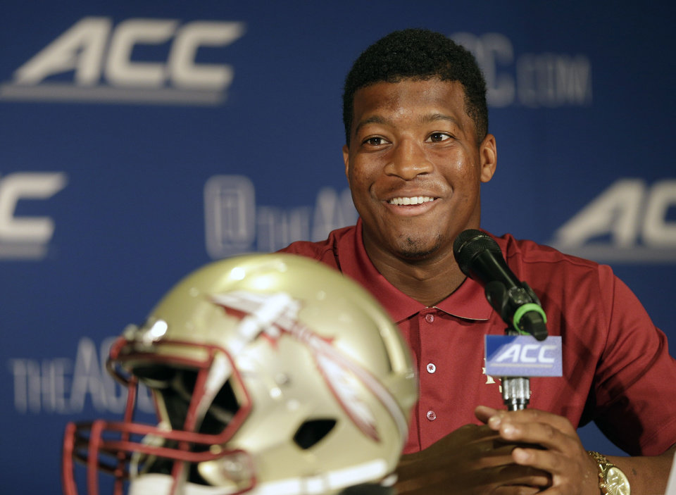 Photo - Florida State's Jameis Winston answers a question during a news conference at the Atlantic Coast Conference Football kickoff in Greensboro, N.C., Sunday, July 20, 2014. (AP Photo/Chuck Burton)