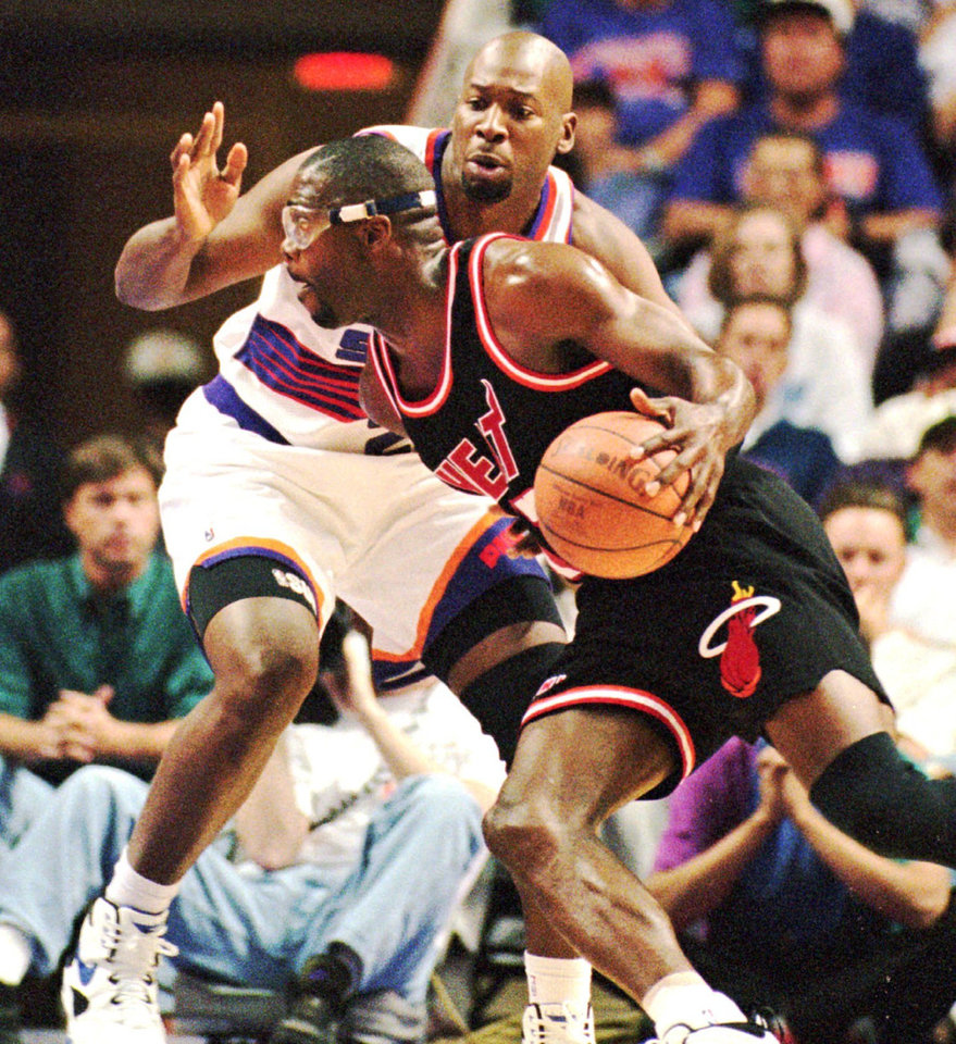 Photo - Miami Heat basketball forward Grant Long gets a step on Wayman Tisdale of the Phoenix Suns as he goes to the basket in the first quarter in Phoenix, Ariz., Sunday, Nov. 6, 1994.  The Suns won 119-107.  N8 LONG   BLACK AND WHITE FIRST EDITION SPORTS