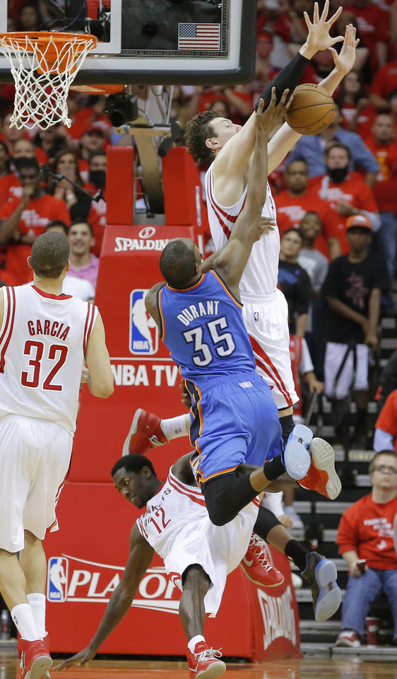 Photo - Oklahoma City's Kevin Durant (35) is called for an offensive foul as he runs into Houston's Patrick Beverley (12) and Omer Asik (3) during Game 4 in the first round of the NBA playoffs between the Oklahoma City Thunder and the Houston Rockets at the Toyota Center in Houston, Texas,Sunday, April 29, 2013. Oklahoma City lost 105-103. Photo by Bryan Terry, The Oklahoman