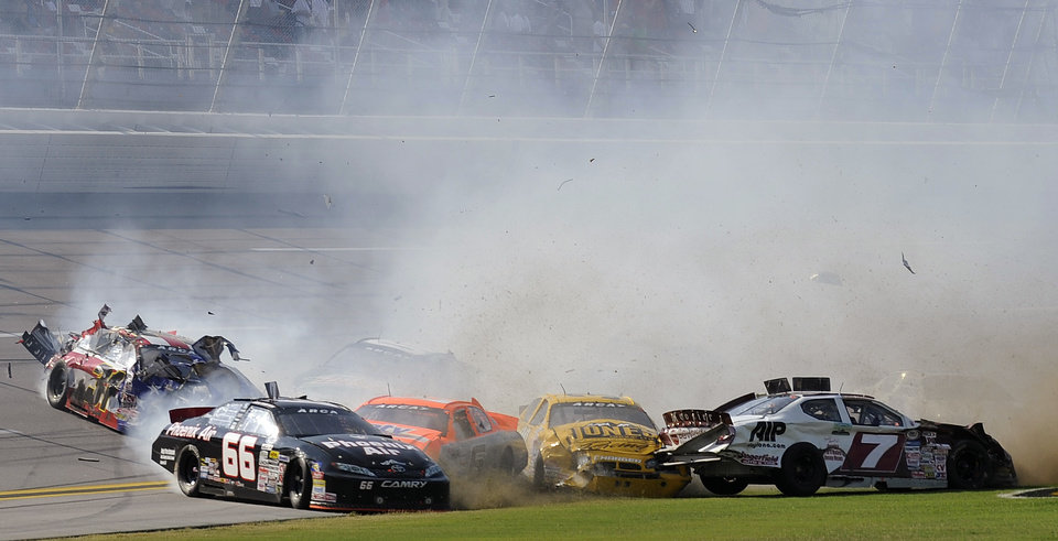 Photo -   Drivers including Mike Harmon (31), Mark Thompson (66), Milka Duno (6) and George Cushman (7) collide during the International Motorsports Hall of Fame 250 ARCA auto race at the Talladega Superspeedway in Talladega, Ala., Friday, May 4, 2012. (AP Photo/Rainier Ehrhardt)