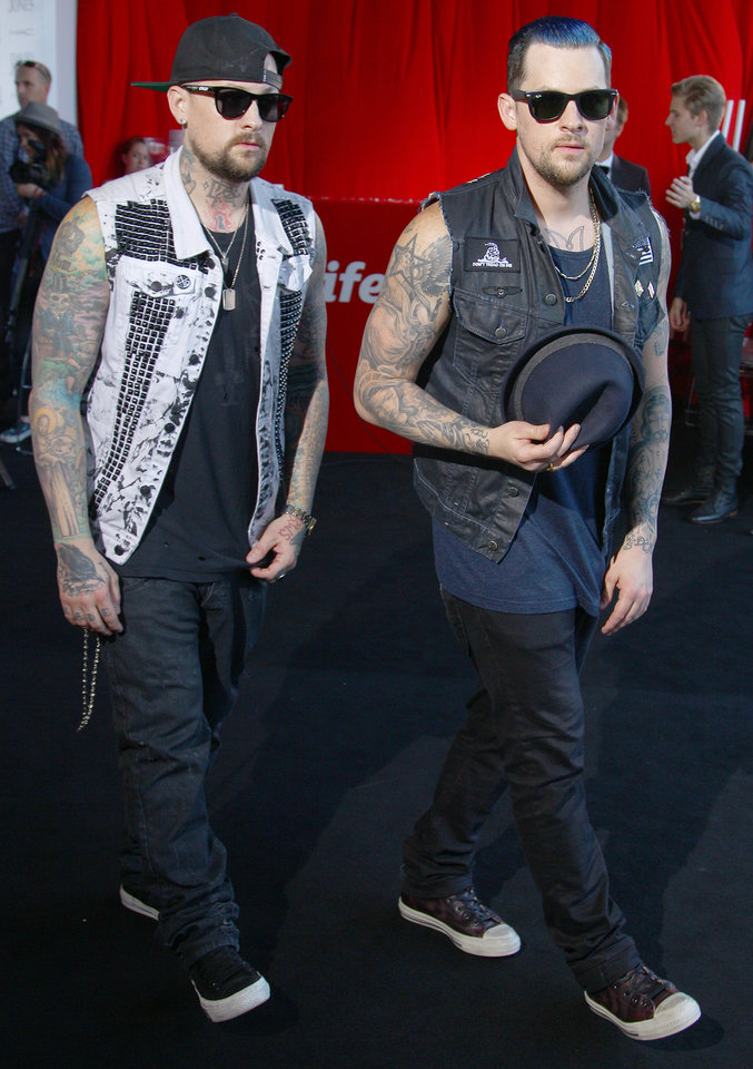 American rockers brothers Joel, right, and Benji Madden arrive for the Australian music industry Aria Awards in Sydney, Thursday, Nov. 29, 2012. (AP Photo/Rick Rycroft)