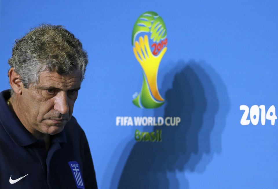 Photo - Greece's head coach Fernando Santos arrives for a press conference of Greece in Natal, Brazil, Wednesday, June 18, 2014.  Greece play in group C of the 2014 soccer World Cup. (AP Photo/Shuji Kajiyama)
