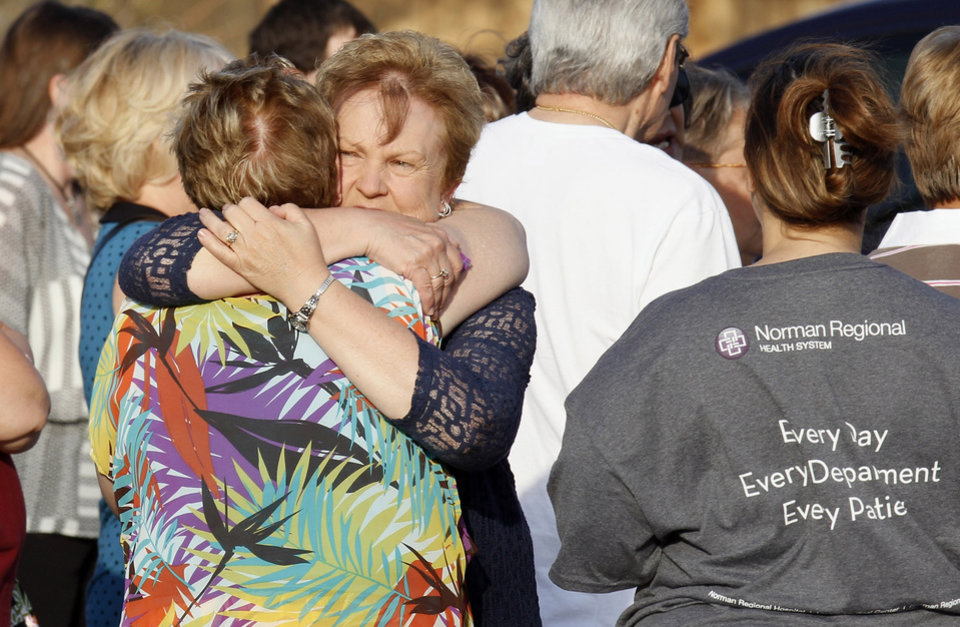 Alyson Heeke, Moore Family Birth Center nurse manager,  hugging Debbie Steele, back showing, Moore Medical Center volunteer coordinator, during a Moore Medical Center remembrance ceremony in Moore Tuesday, June 25, 2013. Demolition began of the medical center after the ceremony. Photo by Paul B. Southerland, The Oklahoman